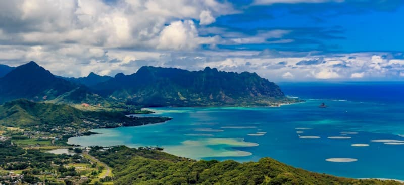 Kualoa Regional Park (center) and Chinaman's Hat Island (right) seen over Kaneohe Bay