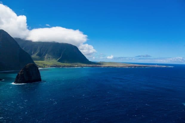 Sea cliffs at the Pali coast with Kalaupapa in the distance