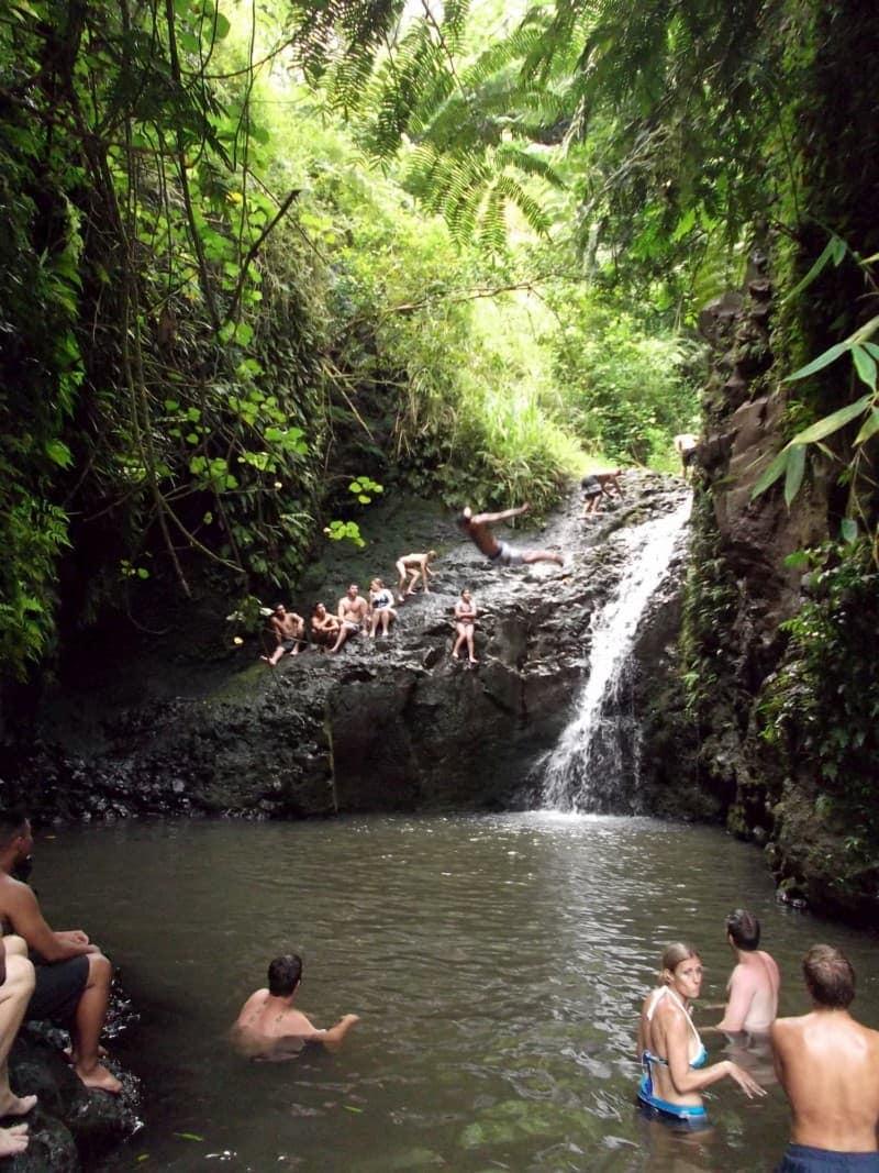 people swimming at the Maunawili Falls
