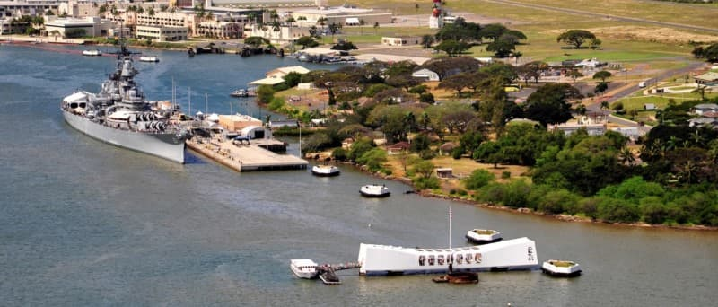 aerial view of Pearl Harbor showing the Battleship Missouri Memorial, Ford Island Field Control Tower, and the USS Arizona Memorial